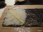 41. Tsuru - Start of a temaki (hand roll). Cover half the nori with rice and add mayo