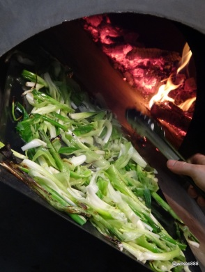 "Homeslice - Spring Onions Roasting for the ""Bone Marrow, Spring Onion & Watercross"" Pizza"