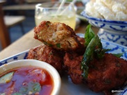 The Begging Bowl - Fishcakes appear to be handmade, thick portions with embedded lime leaves