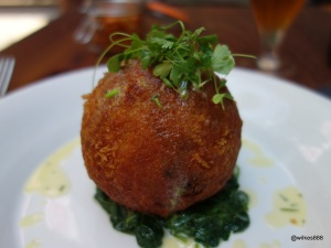 Whyte & Brown - Lemon Leek Risotto Scotch Egg (Soft-boiled egg neslted within luscious herbaceous risotto ball, perched on wilted spinach with chive & lemon butter sauce)