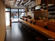 Koya Bar - Venue has a long kitchen with 12 seats around the outside.