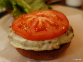 Grillshack - Burger comes with cheese nicely melted and a large slice of beef tomato