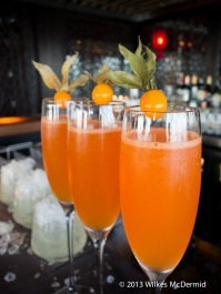 Hutong - The Chinese Lantern (Fresh mandarin, Aperol, St. Germain, passion fruit syrup, plum bitters, Champagne)