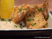 Sesame Crumbed Cuttlefish served with chives, a slice of lemon and thousand island dressing...
