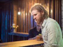 The obligatory bearded bartender...